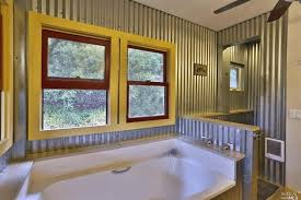 eclectic master bathroom with interior wallpaper ceiling fan in