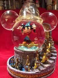 light up snow globe retired disney light up musical snow globe the sorcerer s