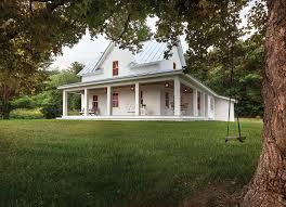 Farmhouse With Wrap Around Porch Farmhouse Style Two Story House Has Garage With Dormers On Side
