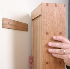 How To Hang Shelves by How To Hang A Cabinet On The Wall Finewoodworking