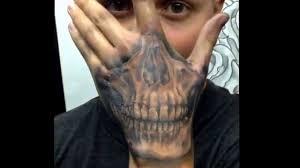 back of hand tattoos skull hand tattoo youtube