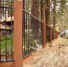 iron fence with wood posts and base fence rail deck