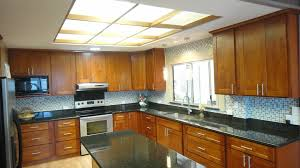 light cherry wood kitchen cabinets light cherry c c cabinets and granite