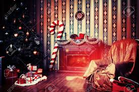 christmas home decoration with tree gifts and fireplace stock