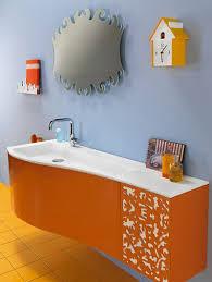 bahtroom unique mirror design above long sink on bathroom cabinets