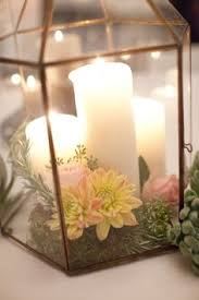Lanterns With Flowers Centerpieces by Small Bronze Lantern Filled With Spanish Moss And Accented With A
