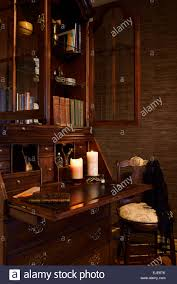 Antique Desk Secretary by Antique Secretary Writing Desk In Moody Dark Room With Candles And