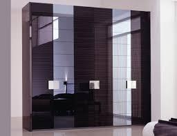 black gloss modern wardrobe design with triple door also hidden