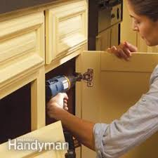 How To Spray Paint Kitchen Cabinets Family Handyman - Spray painting kitchen cabinets
