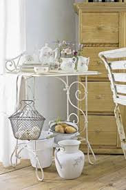 shabby chic decor with rustic accessories and natural focal point