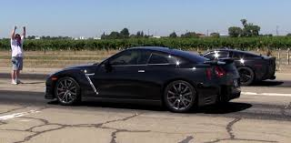 nissan gtr vs porsche 911 nissan gt r drag races c6 corvette z06 with a crushing result