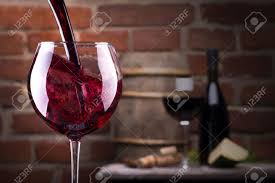 glass of wine glass of wine and some fruits bottle of wine cheese against