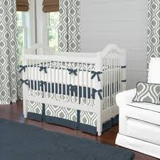 gray baby bedding set for white wooden crib and white leather