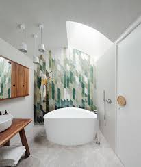 top bathroom trends set to make a big splash in 2016 exquisite tiled accent wall for the contemporary bathroom design day bukh architects