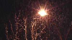 the streetlight in snow covered park lights warm yellow light the