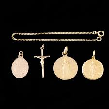 religious pendants gold chain bracelet and four religious pendants expertissim
