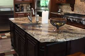unusual kitchen design with brown kitchen cabinet and granite
