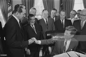 John F Kennedy Cabinet Members President John F Kennedy Passes The Pen To Philippines Senator