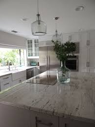 white kitchen cabinets with river white granite river white granite transitional kitchen sherwin
