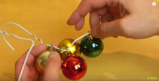 how to make a wreath out of ornaments and a hanger tiphero