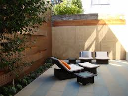 Asian Patio Design White Cushioning And Textured Retaining Walls Asian Patio Design