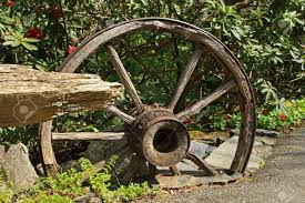wooden wagon wheel as garden ornament stock photo picture and