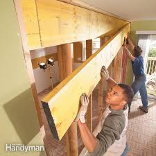 How To Build A Dividing Wall In A Room - how to install a load bearing wall beam family handyman