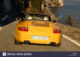 orange porsche 911 convertible car porsche 911 carrera convertible model year 2005 yellow