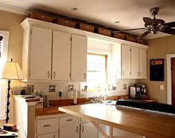 ideas for tops of kitchen cabinets baskets above kitchen cabinets for the home punch