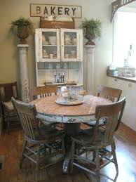 round farmhouse kitchen table small round farmhouse table old cupboard bakery sign diy small