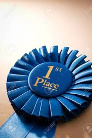 pleated ribbon blue place winner rosette or badge from pleated ribbon stock