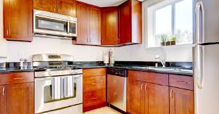 what color countertops go with wood cabinets cherry kitchen cabinets all you need to