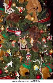 stuffed animals used as tree ornaments on a tree that