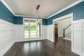 beautiful craftsman style trim work with a soothing blue paint in