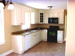 example of a small transitional u shaped enclosed kitchen design