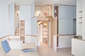 multifunctional wall adds two bedrooms to this tiny studio