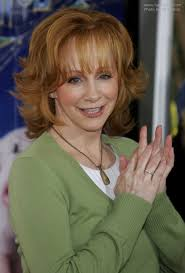 flipped up hairstyles reba mcentire s practical and bouncy red hair with flipped out ends