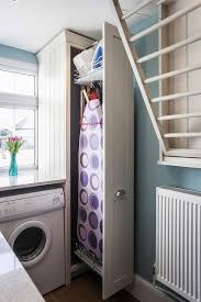 pull out laundry room cabinet with ironing board transitional