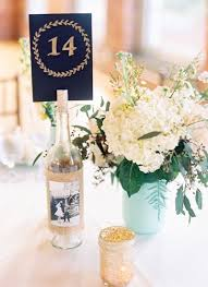 gold wine bottle table numbers gold glitter raleigh wedding by nancy ray photography wedding