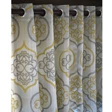 pair of geometric light gold damask curtain panels