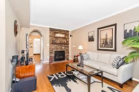 living room with hardwood floors metal fireplace in frederick