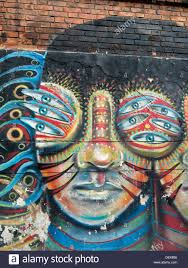 fantasy street art mural on brick wall in bogota colombia stock fantasy street art mural on brick wall in bogota colombia