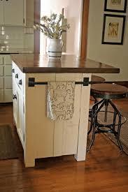 kitchen island with wheels kitchen island carts beige granite backsplash chic white wooden