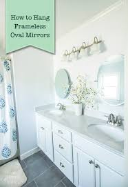 How To Hang A Bathroom Mirror by How To Hang A Frameless Oval Mirror Pretty Handy