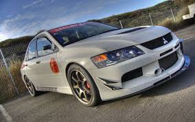 mitsubishi lancer evo modified file white lancer evo front jpg wikimedia commons