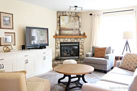 south facing living room with stone corner fireplace furniture