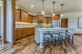 wood kitchen cabinets with white island lovely kitchen with brown cabinets and white island