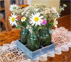 jar flower centerpieces 35 thrifty jar centerpieces that look simply amazing ritely