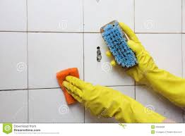 cleaning of dirty old tiles in a bathroom royalty free stock image