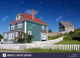 houses with white picket fences in the town of trinity bonavista